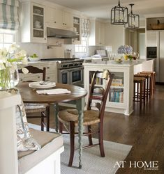 Benjamin Moore's Carrington Beige Paint on Cabs, Princess White granite on the island, subway tile backsplash, Roman shades, Kitchen Aid appliances, Kohler apron-front sink and hardware from Restoration Hardware.