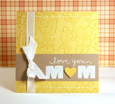 Mom will love this cheery yellow handmade Mother's Day Card!  The kraft paper is a nice contrast to the white stamped sentiment and matching heart.
