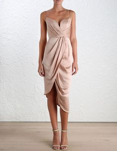 Sueded Silk Plunge Dress, from our Spring 16 collection, in Peony sueded silk. Draped detail through bodice and skirt. Fully boned bodice with wired plunge neckline and shoestring straps. Asymmetric draped skirt. Centre back zip closure, fully lined.