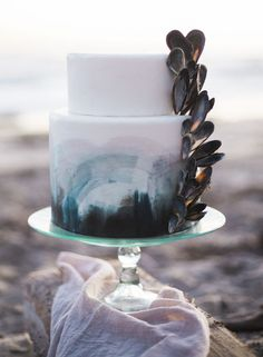 """Wedding Cakes Beach wedding cake idea - beach wedding cake decorated with blue ombre fondant and mussel shells {Ashley dePencier Photography} - Saying """"I do"""" by the sea? These enchanting and elegant mermaid wedding ideas are straight out of a fairytale. Crazy Wedding Cakes, Wedding Cake Photos, White Wedding Cakes, Blue Beach Wedding, Seaside Wedding, Nautical Wedding, Wedding Cake Decorations, Wedding Cake Designs, Contemporary Wedding Cakes"""