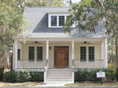 Small white cottage house with large porch and generous front steps