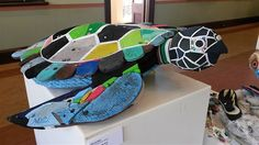 Artist David Day creates this turtle from 60 pairs of thongs that had washed up on the beach.