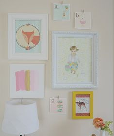 Eclectic gallery wall in a shared girls room