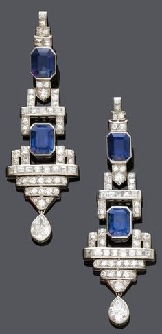 A PAIR OF ART DECO SAPPHIRE AND DIAMOND EAR PENDANTS, CIRCA 1930. Each set with…