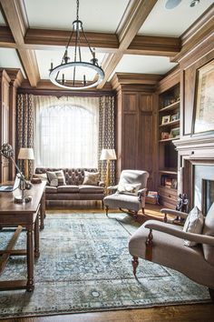 Breaking Tradition: an antique Tabriz rug grounds office. The built-in walnut cabinetry enrich the handsome room.