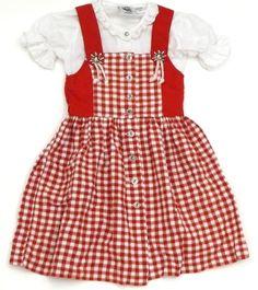 Rot-weiß-kariertes Dirndl-Kleid mit Trägern zum Knöpfen (hinten) und Zierknöpfen in Edelweißform und Bluse mit Puffärmeln und Spitzenborte der Marke Isar Trachten in Gr. 92