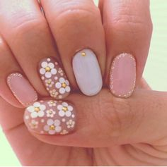 ..punch up the pastels and copy the daisy accent nails...