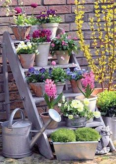Potted Flowers This is a great idea for a deck or limited space. I don't know if I'd leave the wood plain or do a milk-paint look.