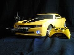 Transformers Bumblebee Xbox 360 Slim Casemod: An Xbox 360 Slim is installed inside a remote control Camaro; the DVD tray comes from the front of the car, while in the rear window is an 8 inch display. Transformers Bumblebee, Xbox Games, Fun Games, Retro Games, First Video Game, Video Games, Ps3, Manette Xbox 360, Tennis For Two