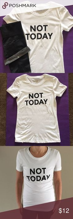 "Graphic White Fitted T-Shirt (Not Today) Fitted white t-shirt. Can be worn for working out or a casual day on the town. Runs a little small so my reco is to size up.  Made from 60/40 cotton/polyester. Body width across 17 3/4"". Tops Tees - Short Sleeve"
