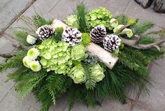Fresh floral centrepiece for your holiday table. Complete with antlers! Designed by CB Flower Boutique