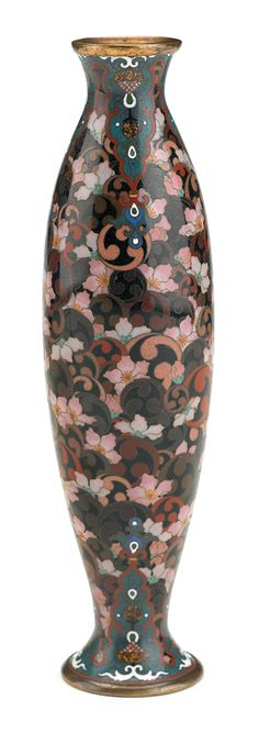 Rare Japanese cloisonné enamel vase  mark of honda kozaburo, meiji period  The slender cylindrical vase that tapers to splayed foot and everted rim vividly decorated to show many swirl kamon nestled among pink blossoms.