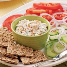 Creamy smoked trout spread on thin whole-grain crackers is a delicious appetizer, but serve it with an array of artfully arranged nibbles—ripe tomatoes, crunchy cucumber slices and red onion—and you have an easy summer dinner.