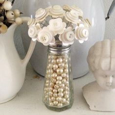 Button Bouquet Flowers in Bead Filled Vintage Salt Shaker Wedding Decor 2019 Craft: white button flowers in salt shaker with beads The post Button Bouquet Flowers in Bead Filled Vintage Salt Shaker Wedding Decor 2019 appeared first on Vintage ideas. Button Bouquet, Button Flowers, Tall Flowers, Button Art, Button Crafts, Vase Deco, Arts And Crafts, Diy Crafts, Frame Crafts