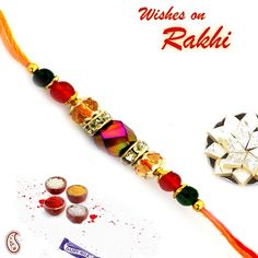 Coloured Crystal and White Stone Hoops Jewel Rakhi : buy flowers online, buy cake online, send flowers, cakes to India