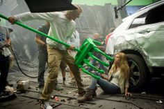 Left to right: Director/Executive Producer Michael Bay demonstrates a scene with Nicola Peltz (who plays Tessa Yeager) on the set of TRANSFORMERS: AGE OF EXTINCTION