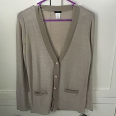 J. Crew striped cardigan Tan/cream striped cardigan with cream buttons. Two small pockets on the front. Size small. New without tags. J. Crew Sweaters Cardigans