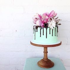 Flowers, macarons and a chocolate drip by @mudgeemama how good is the ''borrowed' magnolia?!