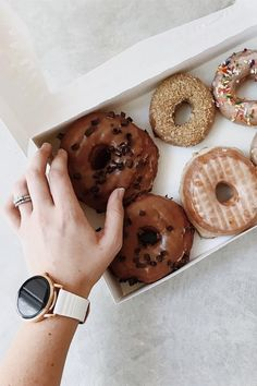 Our two on the go essentials: donuts and the Q Wander rose gold smartwatch. @ rachellynphotog