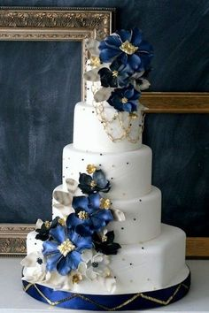 "25 Delightful Wedding Cakes with Cascading Florals A white, blue, & gold wedding cake could work as your ""Something Blue."" Would you consider it? Ron Ben-Isreal via Nuovo Bride Ready to see some truly delectable wedding cakes almost too . Navy Blue Wedding Cakes, Crazy Wedding Cakes, Blue Gold Wedding, Elegant Wedding Cakes, Beautiful Wedding Cakes, Gorgeous Cakes, Wedding Cake Designs, Pretty Cakes, Cake Wedding"