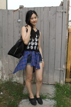 Shop this look on Lookastic:  http://lookastic.com/women/looks/tank-dress-shirt-shorts-loafers-duffle-bag/3165  — Black and White Print Tank  — Blue Plaid Dress Shirt  — Navy Denim Shorts  — Black Leather Loafers  — Black Suede Duffle Bag