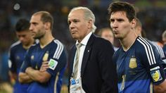 Argentina's forward and captain Lionel Messi (R) and Argentina's coach Alejandro Sabella (C) react after losing the 2014 FIFA World Cup final match against Germany