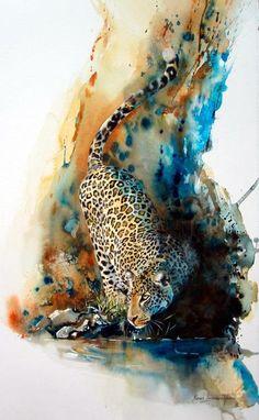 Hidden within the rocks and shadows, she seeks her prey. Great work.       Karen Laurence-Rowe