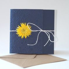 A beautiful dark blue wedding invitation with burlap ribbon and gerbera yellow flower manual fringed paper with scissors . I used a high quality