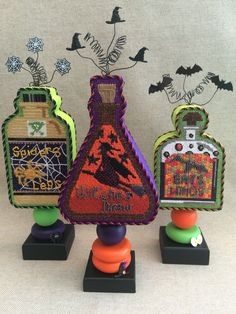 I had so much fun finishing these stand-up bottles, from their swirly spiderweb, witch hat and bat embellished tops to the last details on the stands!!! ~ Canvas designs by Kirk&Bradley