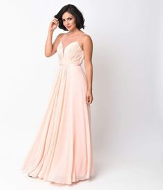 Featuring a tightly pleated, plunging illusion neckline and a delicate A-line silhouette, this fun and flirty Blush Pink Chiffon Illusion Sweetheart Long Gown makes the idyllic blush bridesmaids dress or light pink prom style. Twirl the night away free o