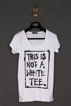 """UNCONDITIONAL white round neck tee with """"This is not a white tee """" print."""