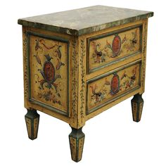 Charming and beautifully painted miniature two drawer chest. Fabulous detailing on all four sides with a faux marble top. c. 1880