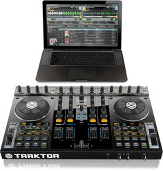 Native Instruments Traktor S4.  Get the SCRATCH UPGRADE and its UNREAL!  4 decks and you can use your TECHNICS1200s!