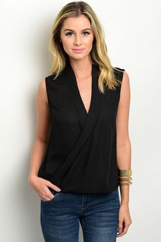 One of our most versatile pieces, this black wrap chiffon blouse is sure to be a closet staple! This sleeveless top features a wrapped front with a pleated collar and bubble hem. Slight high-low desig