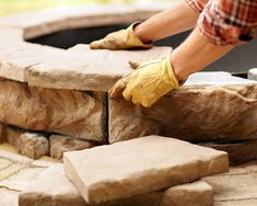 Laying the stones in the Stone Fire Pit DIY Project
