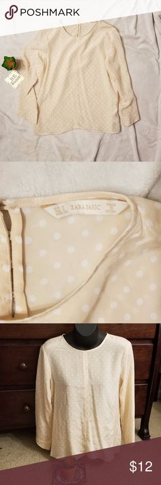"ZARA Peach Polka Dot Blouse ZARA Peach Polka Dot Blouse with button accent on back. 3/4 sleeve top measures 23"" in length and 16.5"" across chest Zara Tops Blouses"