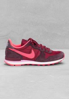 NIKE These sneakers have a retro running shoe style, combining both suede and nylon upper.