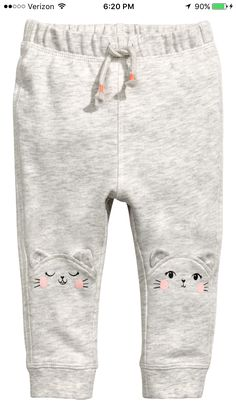 Joggers in lightweight cotton sweatshirt fabric. Elastication and decorative tie at waist, appliqués at knees, and ribbed hems. Baby Outfits, Toddler Outfits, Blouse Volantée, Blouse En Coton, Luxury Baby Clothes, Kids Nightwear, Girls Pjs, Kids Clothes Sale, Baby Girl Pants