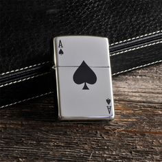 From the first name in lighters comes this sleek selection, perfect for the card shark. The personalized Zippo Aces Lighter features the lucky Ace of Spades on front and lots of room for name or other