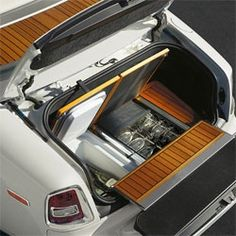 Pop open the trunk of the 2013 Rolls Royce Phantom Drophead Coupé to find yacht inspired teak flooring hiding a mini fridge, custom glasses, and a bench seat for two...