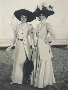 Two Women on Beach wearing large black hats 1900s by Adolph De Meyer