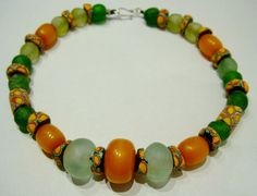 by Eva Manning | Necklace combining  antique yellow and brown Millefiore glass trade beads, white and green frost bottle glass beads from West Africa and Somali amber that is a man-made simulation from end of last century circa 1960 s. | 866$