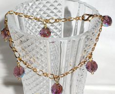 Bracelet with golden chain and light amethyst by Momentidoro, €35.00