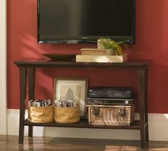 tv mounted on wall with fireplace and table in bedroom - Google Search