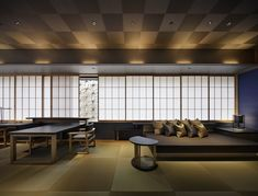 Experience rooms with tatami-covered floors, raised futon beds, and hot spring baths at HOSHINOYA Tokyo
