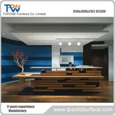 Wooden and corian solid surface reception desk