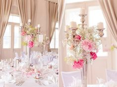 Hochzeits-Tischdeko mit großem silbernen Kerzenständer und Blumen in rosa und pink