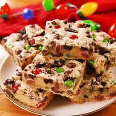 food Loaded with M&Ms, crushed Oreos, and chocolate chips, we could not think of a better way to celebrate the holidays. Holiday Baking, Christmas Desserts, Christmas Treats, Christmas Candy, Xmas, Just Desserts, Delicious Desserts, Yummy Food, Tasty