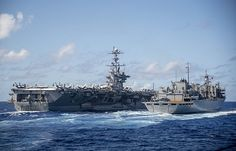 USS John C. Stennis (CVN 74) conducts a replenishment-at-sea with the fast combat support ship USNS Rainier (T-AOE 7).