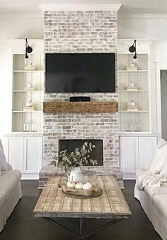 Beautiful white wash brick fireplace with floating wood mantel, and tv above it. White built ins on either side ideas brick 81 Awesome Farmhouse Fireplace Design Ideas To Beautify Your Living Room White Wash Brick Fireplace, Brick Fireplace Makeover, Farmhouse Fireplace, Home Fireplace, Living Room With Fireplace, Fireplace Design, Fireplace Ideas, Rustic Farmhouse, Brick Fireplace Remodel